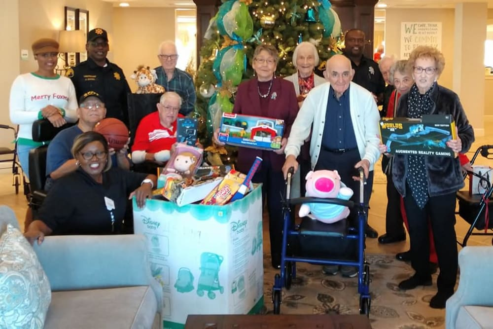 Residents help gather presents at Inspired Living in Sugar Land, Texas.