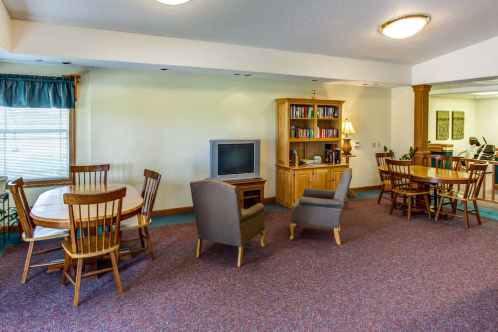 Community activity room with TV at Prairie Hills in Independence, Iowa