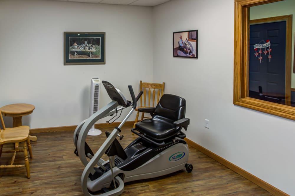 Exercise room with recumbent bike at Prairie Hills Tipton in Tipton, Iowa.
