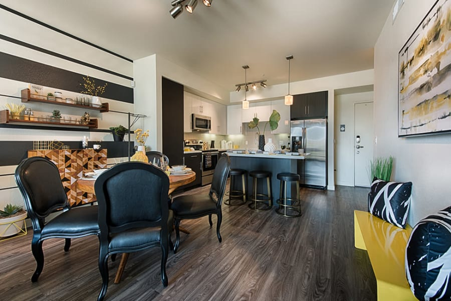 Kitchen and dining space with a breakfast bar at The TOMSCOT in Scottsdale, Arizona