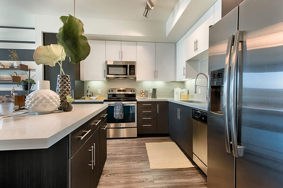 Kitchen with stainless steel appliances at The TOMSCOT in Scottsdale, Arizona