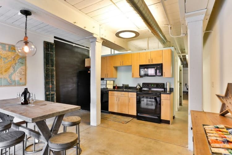 Beautiful kitchen and dining room at Highland Mill Lofts in Charlotte, North Carolina