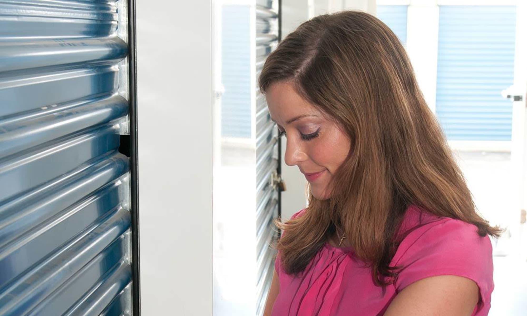 A customer unlocking her storage unit at Virginia Varsity Storage in Roanoke, Virginia