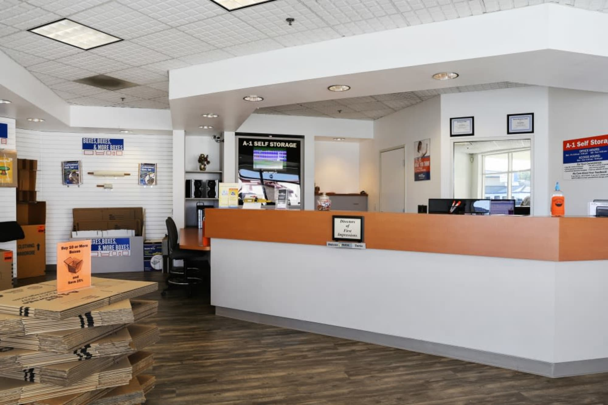 The front desk and a stack of boxes at A-1 Self Storage in Fullerton, California