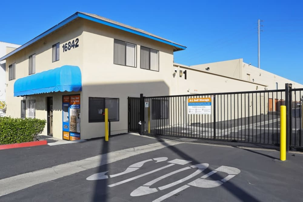 The front entrance and iron gate at A-1 Self Storage in Fountain Valley, California