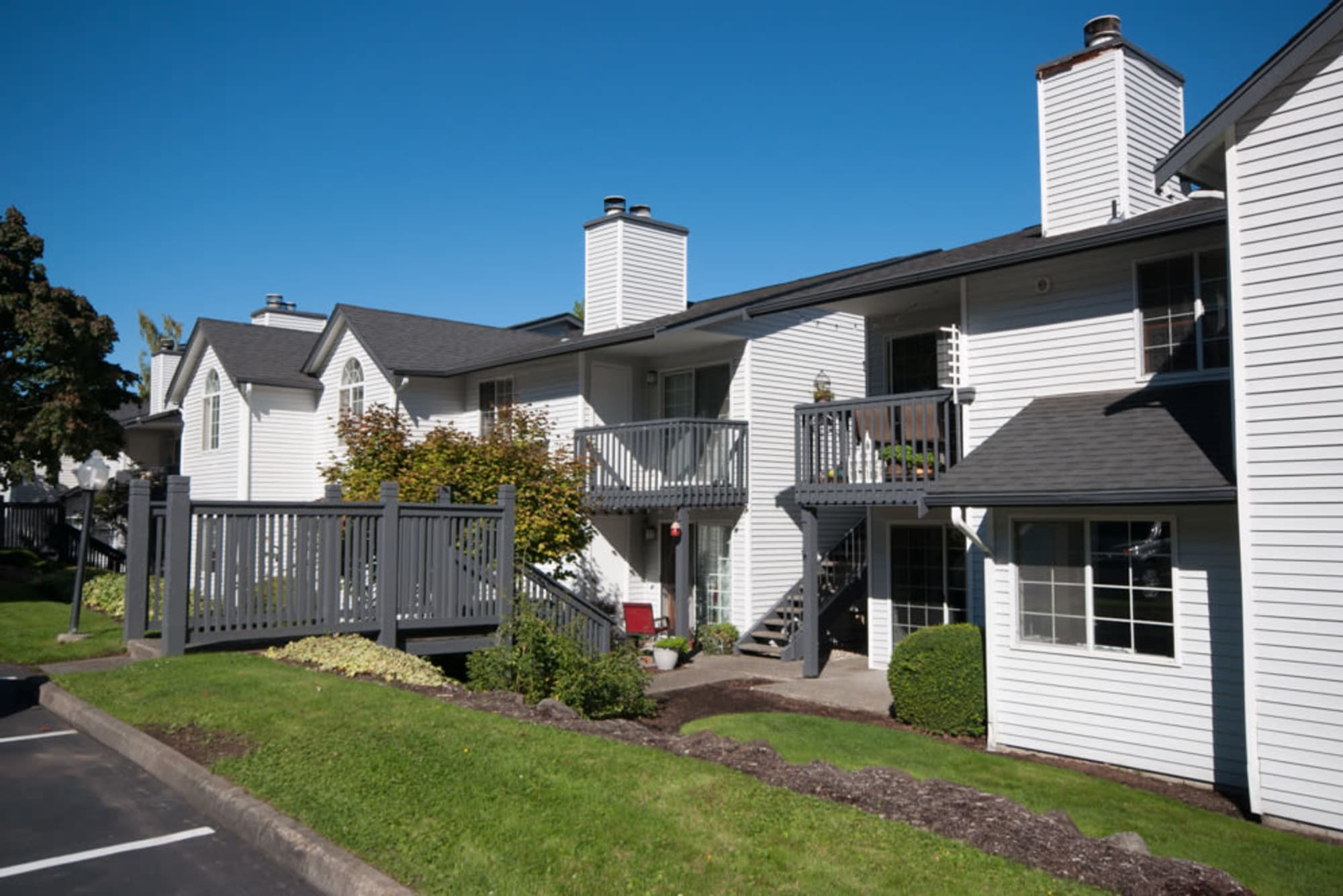 Patios in the sun at Wellington Apartment Homes in Silverdale, Washington