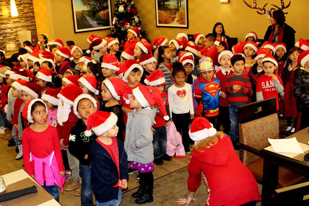 Children Singing Holiday Songs at Merrill Gardens at Santa Maria in Santa Maria, California