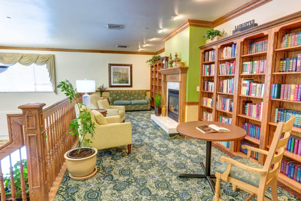 upstairs reading corner with a fireplace at The Wentworth at East Millcreek in Salt Lake City, Utah