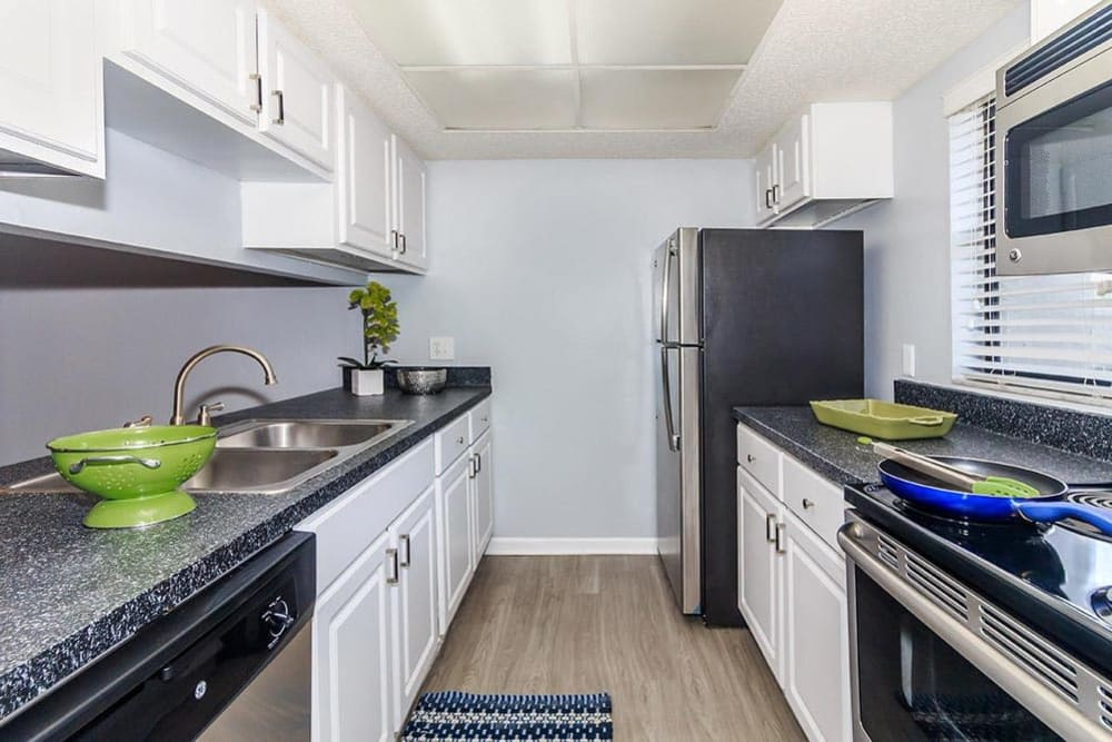 WestEnd At 76Ten model kitchen featuring white cabinetry in Tampa, Florida