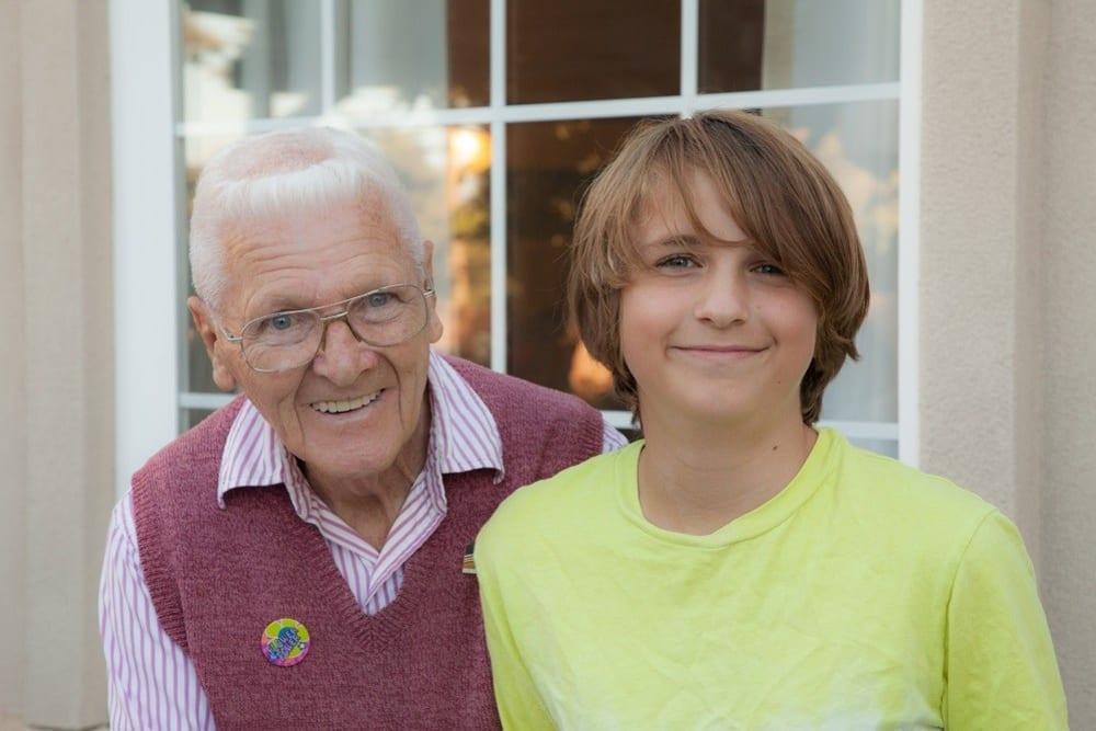 A resident and grandson spending time together at Merrill Gardens at Oceanside in Oceanside, California.