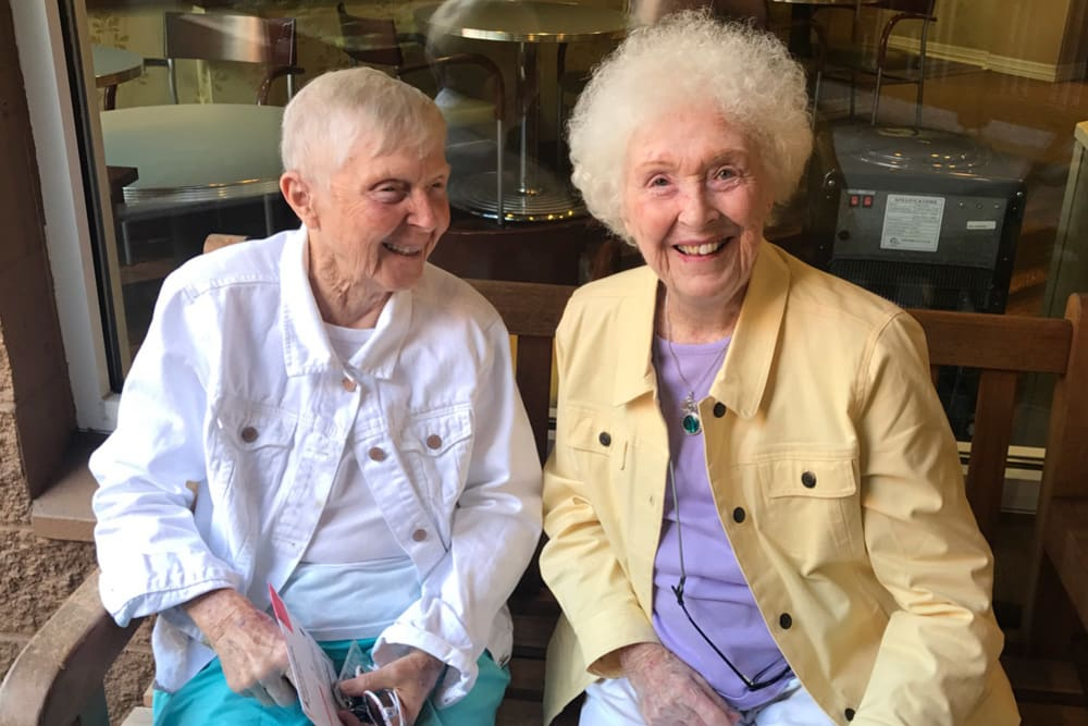 Two resident friends having fun at Merrill Gardens at First Hill in Seattle, Washington.