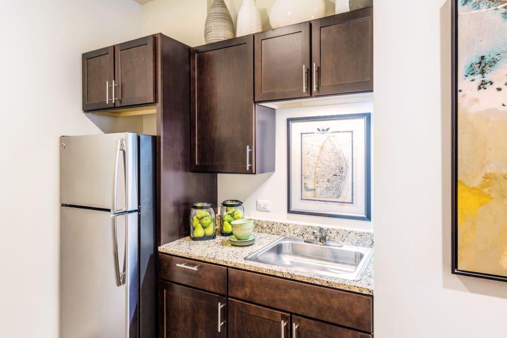 Refrigerator in kitchen at Stonecrest at Clayton View in Saint Louis, Missouri