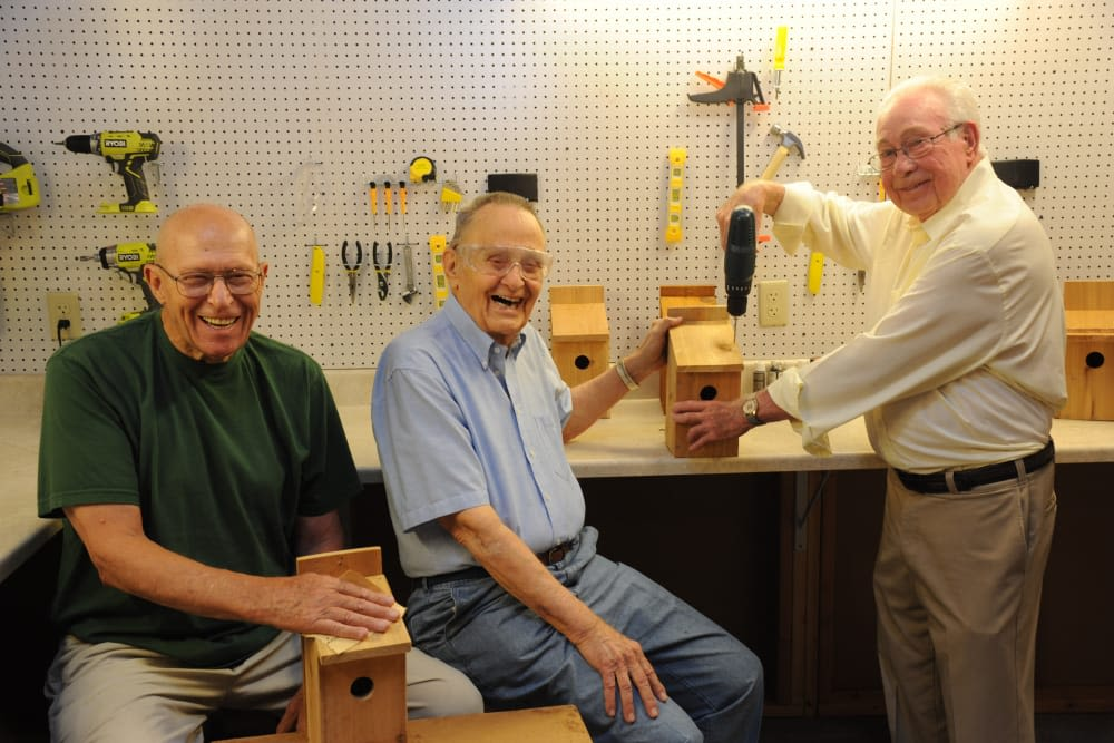 Residents doing woodworking at senior apartments at Arbour Square of Harleysville in Harleysville, Pennsylvania