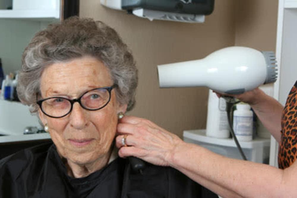 A resident having her hair done at Arbour Square of Harleysville in Harleysville, Pennsylvania