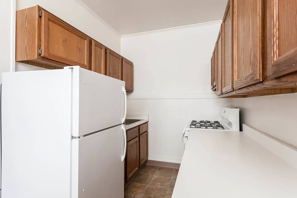 Galley kitchen at Colby, Carlton, and Colby Park Apartments