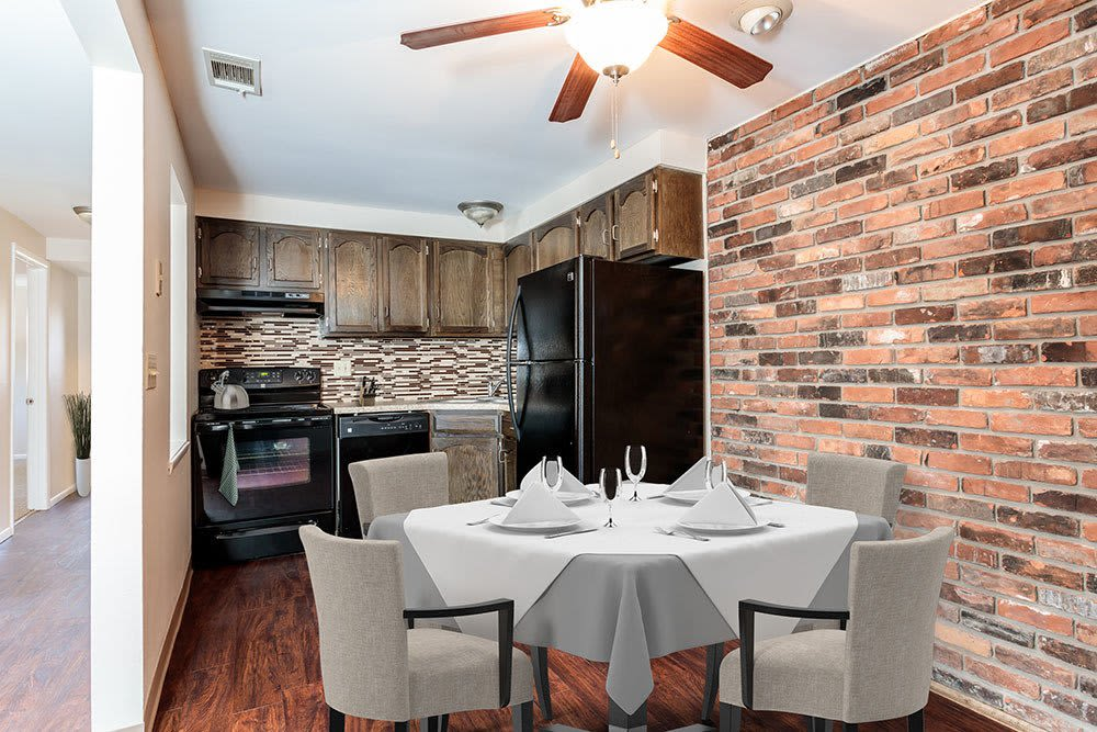 Well-equipped kitchen and dining room at Raintree Island Apartments in Tonawanda