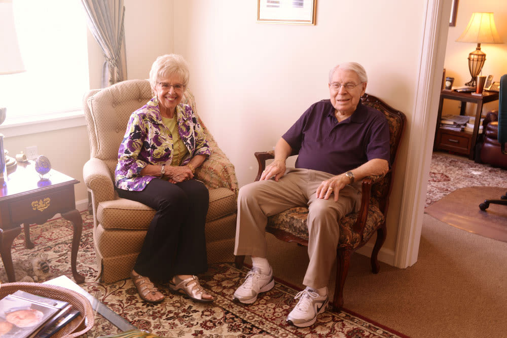 Resident couple sitting in recliner chairs at Quail Park of Lynnwood in Lynnwood, Washington