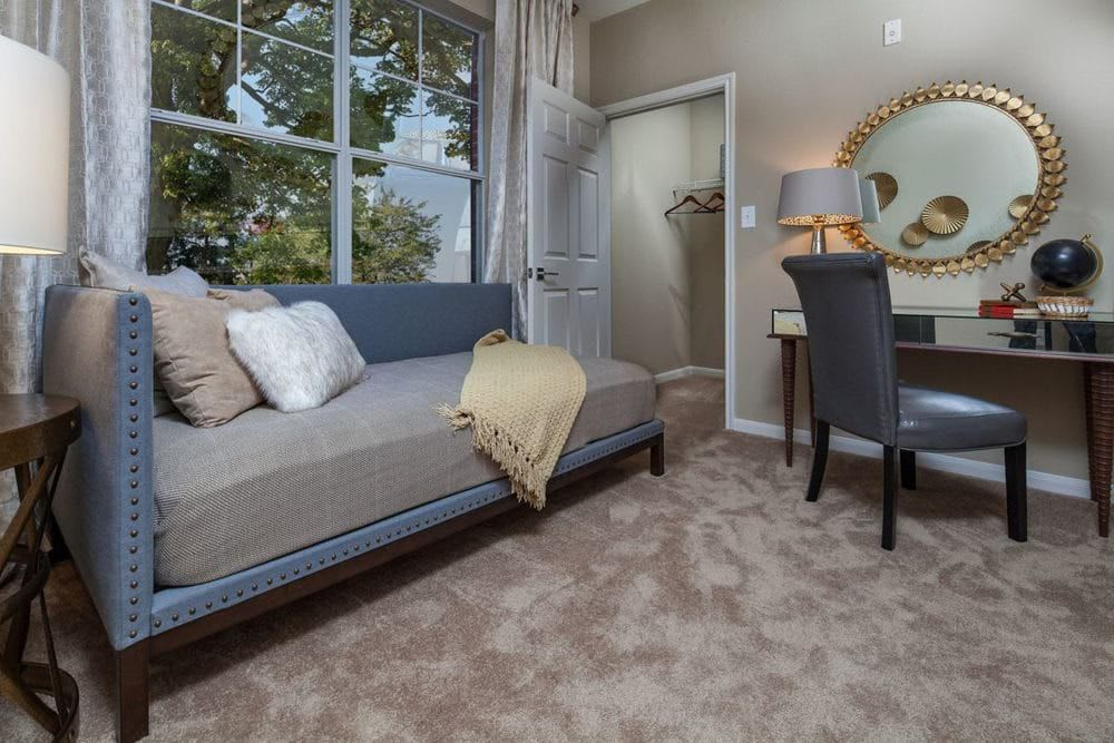 Room with couch and desk at The Spring at Silverton in Fort Worth, Texas
