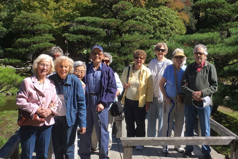 Residents on a hike near Merrill Gardens at The University in Seattle, Washington.