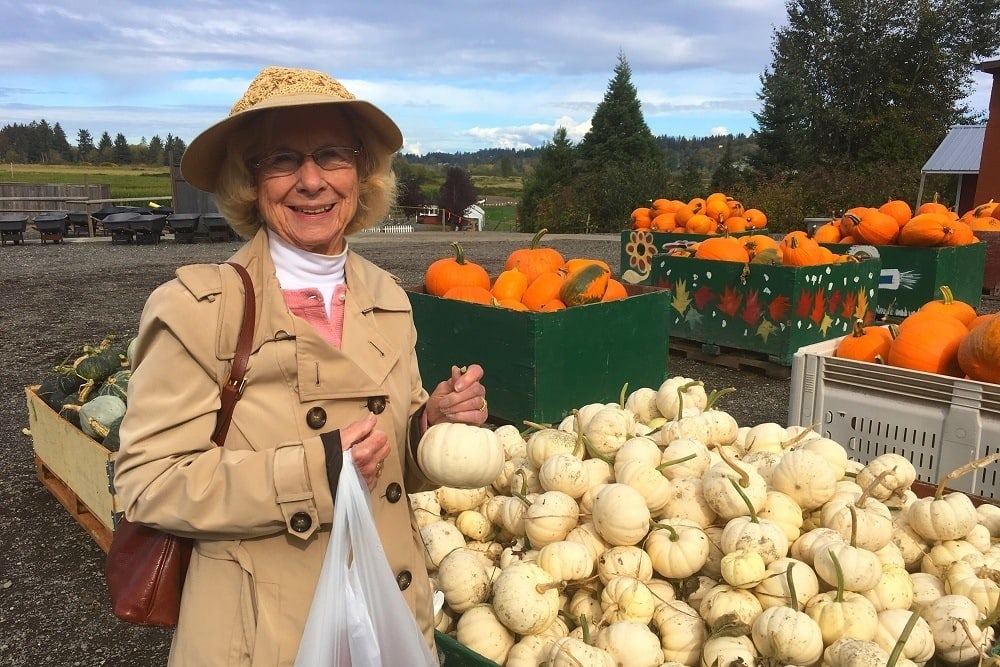 A resident shopping for pumpkins near Merrill Gardens at The University in Seattle, Washington.