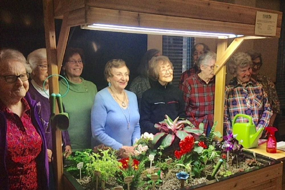 Resident friends spending time together at Merrill Gardens at Madison in Madison, Alabama.