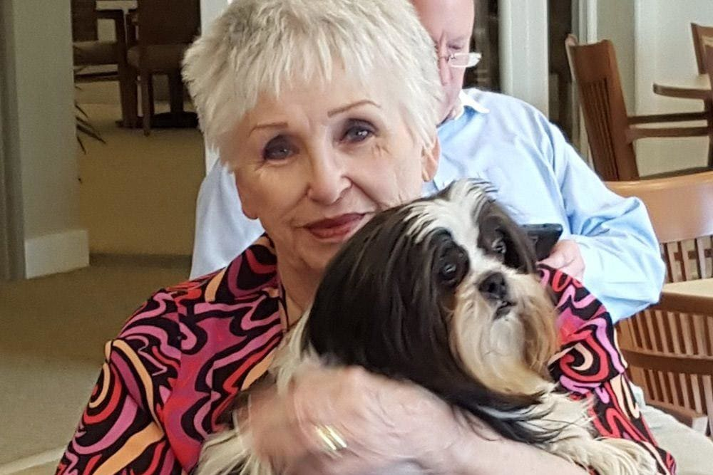 Resident loving her pet at Merrill Gardens at Madison in Madison, Alabama