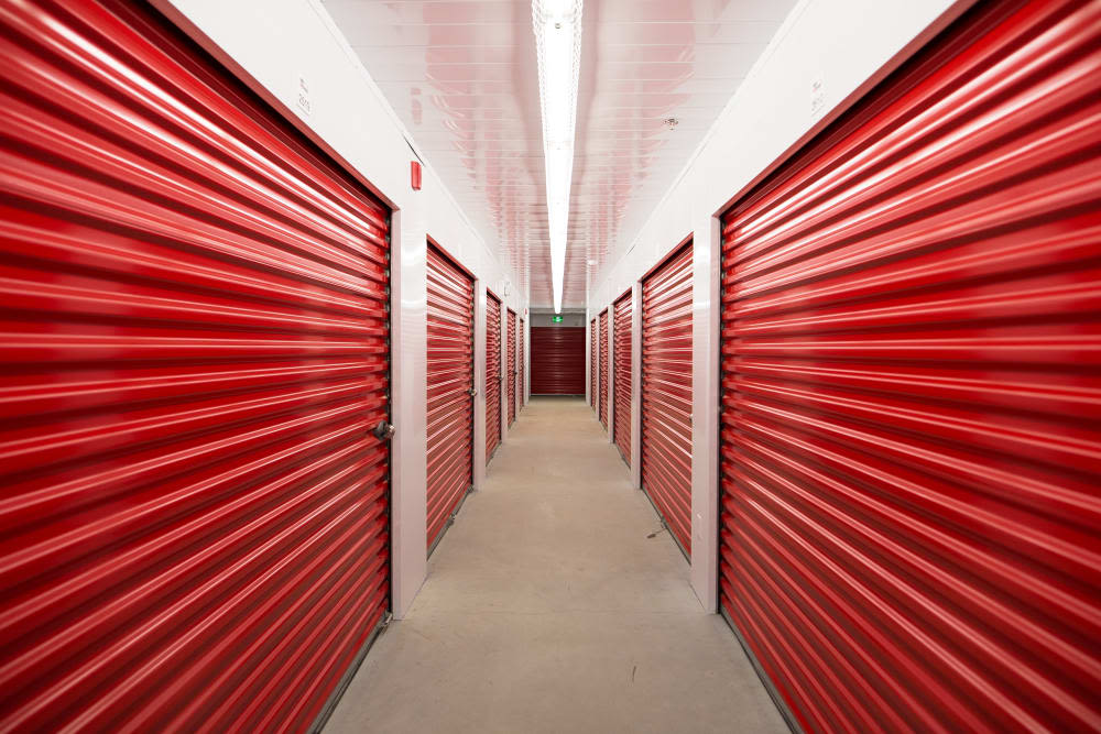 Storage units with red doors at Mini Storage Depot in Knoxville, Tennessee