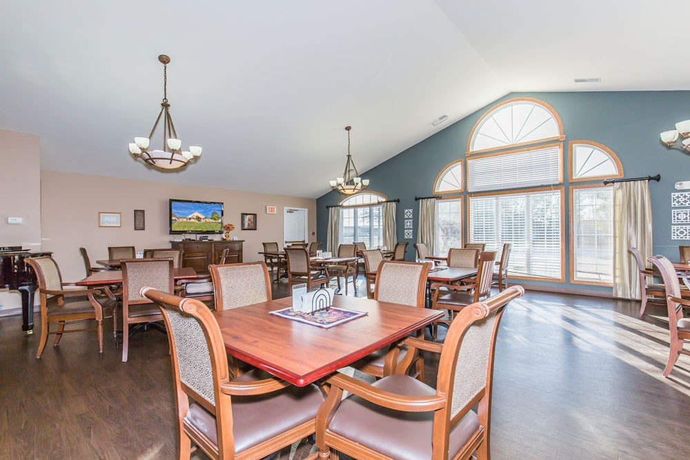 Elegant dining room complete with chandliers at Brookstone Estates of Mattoon North in Mattoon, Illinois