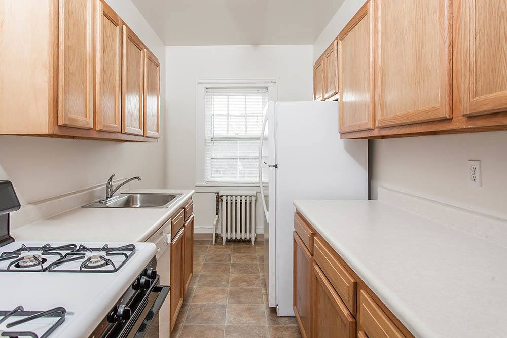 Galley kitchen in apartment at Barrington Apartments