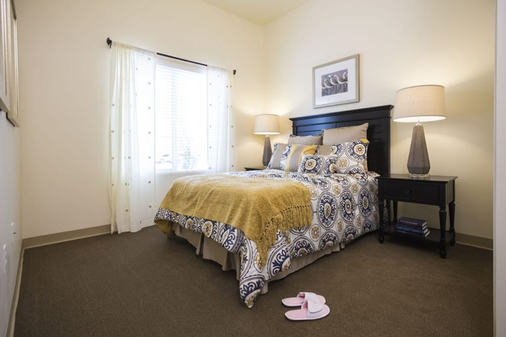 Spacious resident bedroom at The Pointe at Summit Hills in Bakersfield, California.