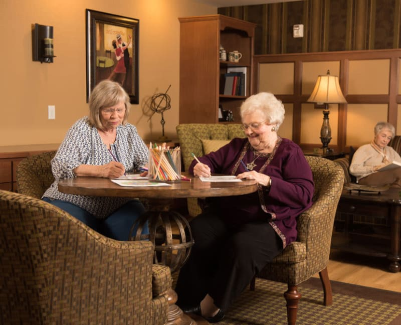 Residents coloring with pencils at York Gardens in Edina, Minnesota