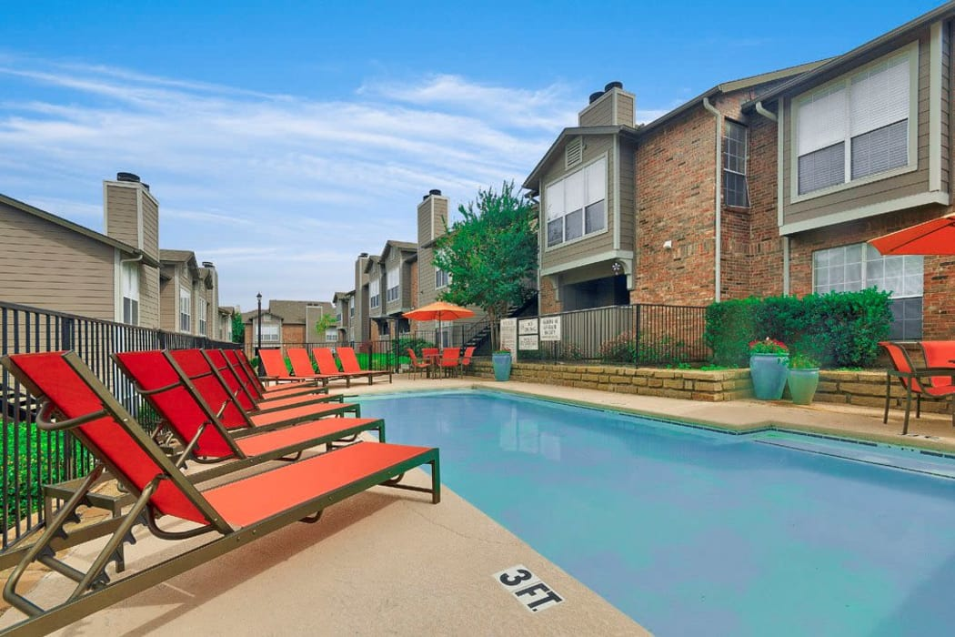 Gorgeous swimming pool area on a beautiful day at Village Green of Bear Creek in Euless, Texas