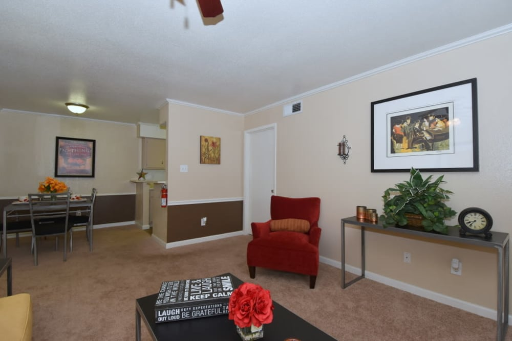 Living room and dining room at Falls of Maplewood Apartments