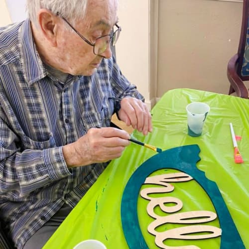 A resident crafting at {location_name}} in Wahoo, Nebraska
