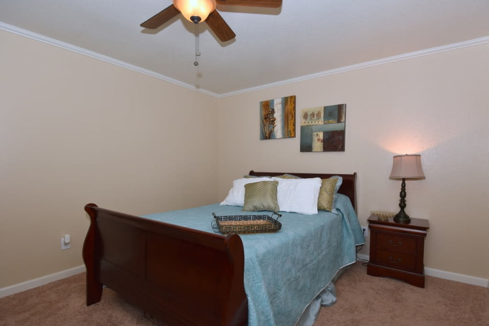 Bedroom with ceiling fan at Falls of Maplewood Apartments