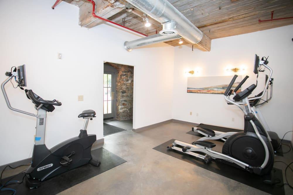 24 hour fitness center at Newnan Lofts Apartment Homes in Newnan, Georgia