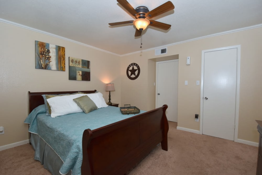 Master bedroom at Falls of Maplewood Apartments