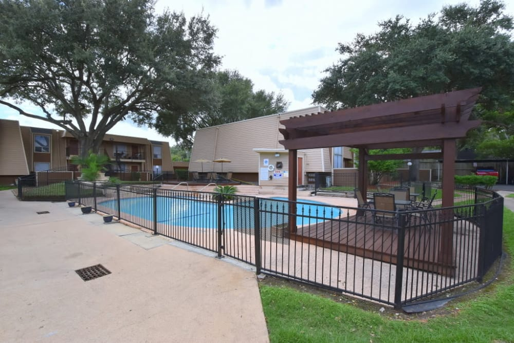 Beautiful swimming pool at Falls of Maplewood Apartments in Houston, Texas