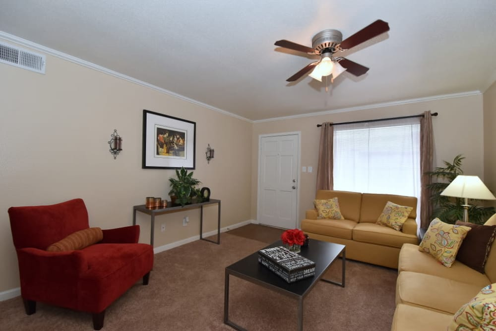 Falls of Maplewood Apartments offers a great living room for entertaining in Houston, Texas