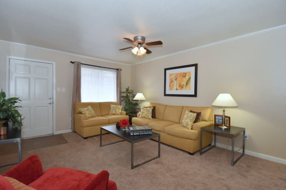 Spacious living room at Falls of Maplewood Apartments in Houston, Texas