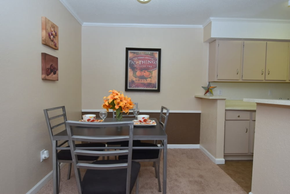 Cozy dining room at Falls of Maplewood Apartments