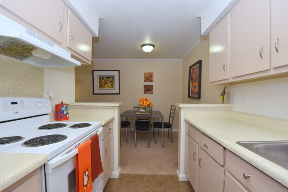 Pass through kitchen at Falls of Maplewood Apartments