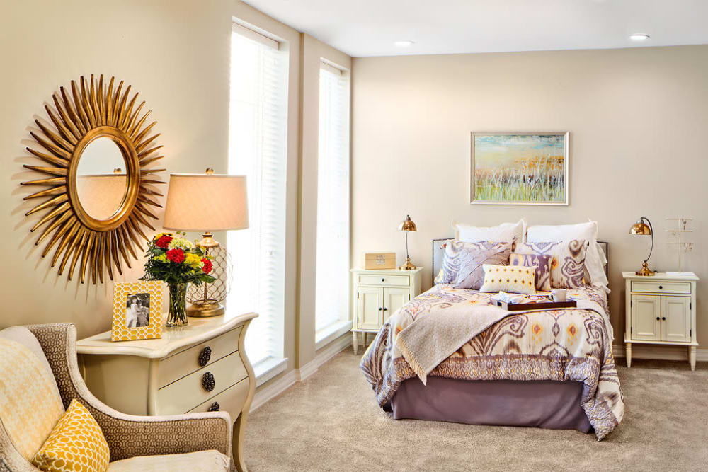 Resident bedroom with large windows at Anthology of Overland Park in Overland Park, Kansas.