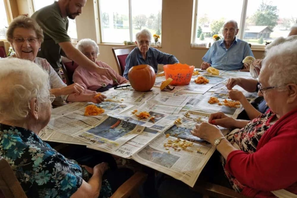 Residents carve pumpkins at Manning Senior Living in Manning, Iowa.
