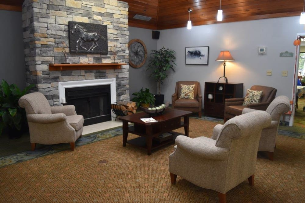 Resident lobby with fireplace at Willow Creek Senior Living in Elizabethtown, Kentucky.