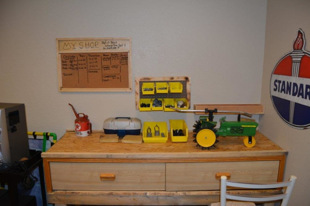 Resident activity room with display of toys at Courtyard Estates at Hawthorne Crossing in Bondurant, Iowa.