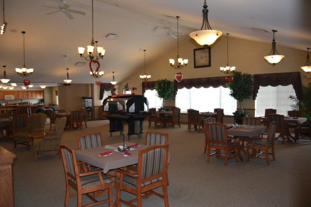 Large bright resident dining room at Courtyard Estates at Hawthorne Crossing in Bondurant, Iowa.