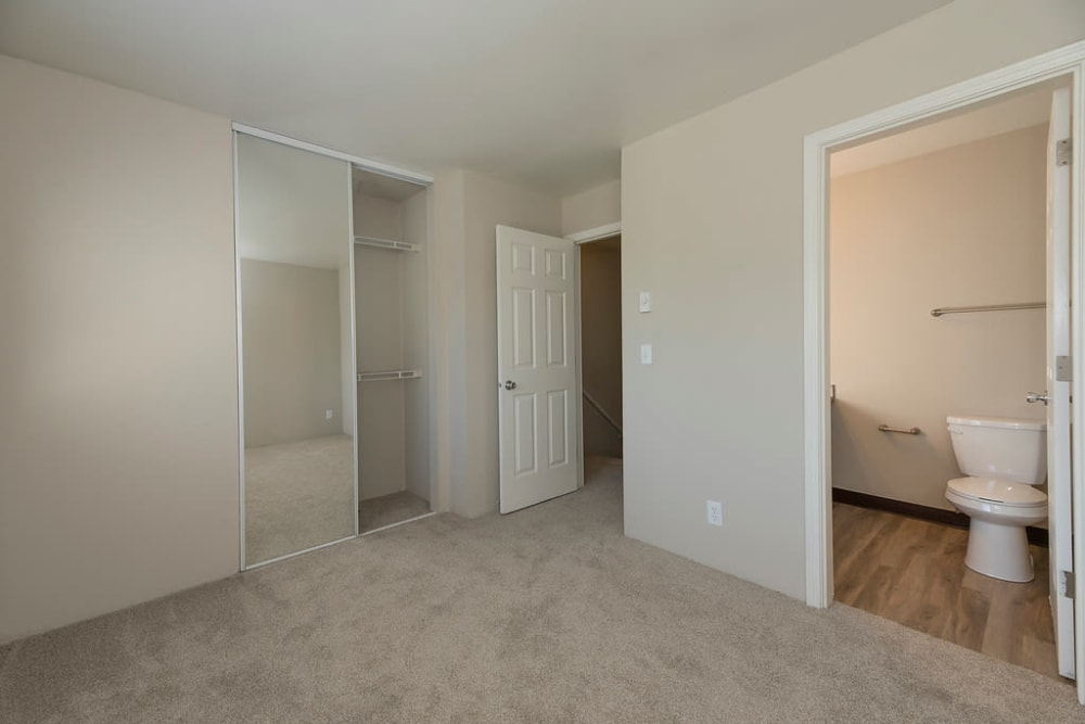 Lovely bedroom with walk-in closet at Waterhouse Place in Beaverton, Oregon