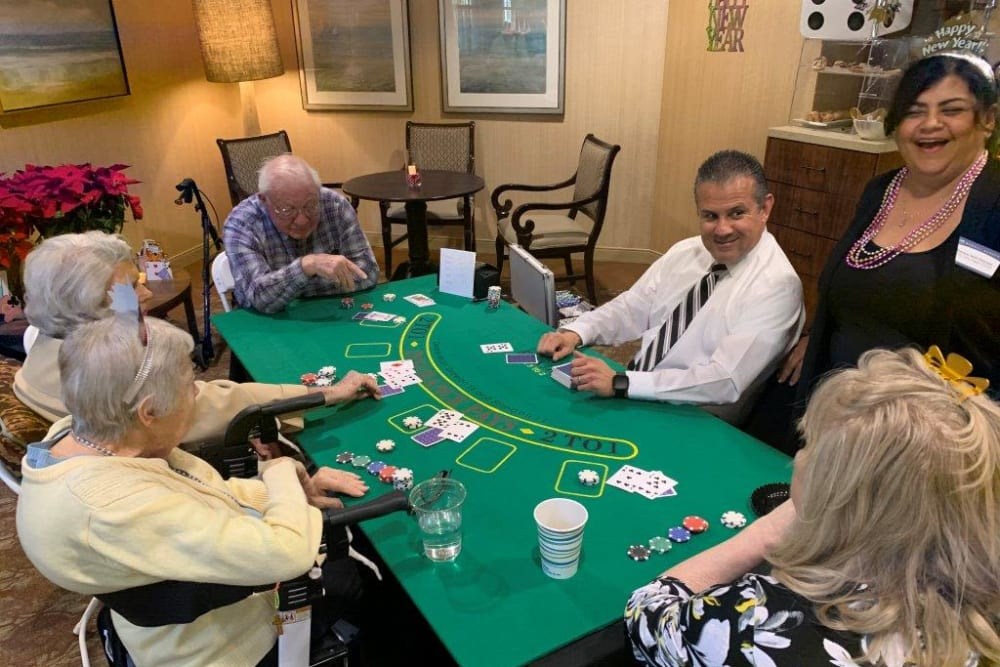 Residents playing cards at Merrill Gardens at Oceanside in Oceanside, California.