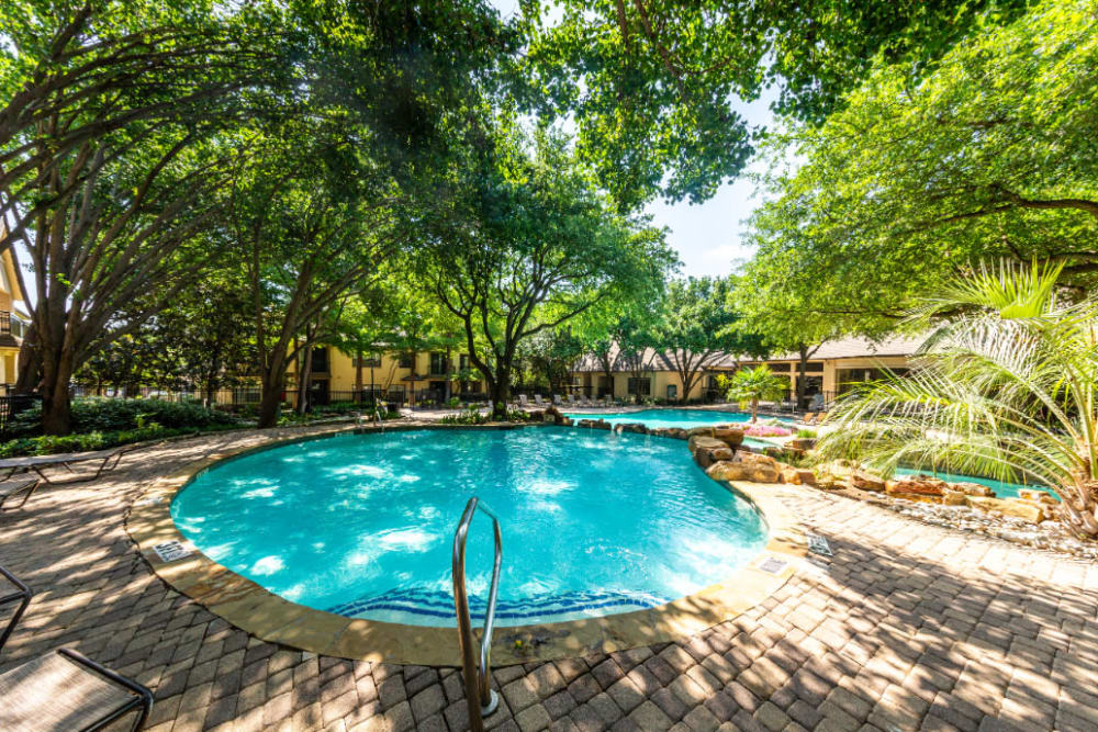 Pool area sectioned off with rocks at Marquis at Waterview in Richardson, Texas